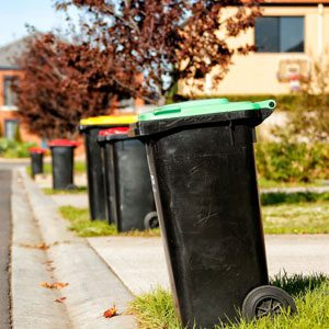 Resource Recovery Gippsland - Line of wheelie bins on kerb